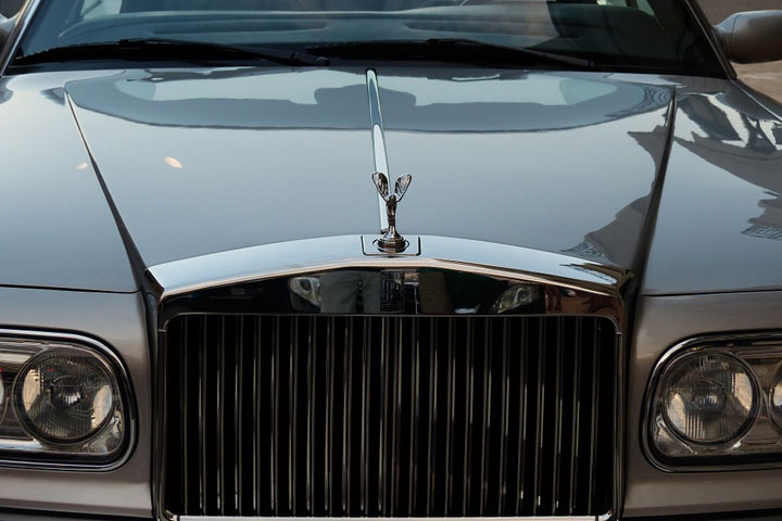 Sovereign Immunity Rolls Royce front of car